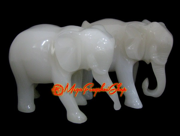 pair of white feng shui elephants with trunks down. Black Bedroom Furniture Sets. Home Design Ideas